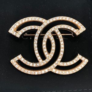 Authentic brand new Chanel gold and crystal brooch